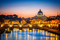 St. Peter`s cathedral at night, Rome. Night view of St. Peter`s cathedral and Tiber river in Rome, Italy Royalty Free Stock Photography
