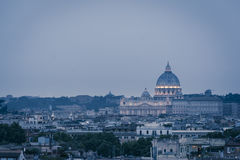 St. Peter`s cathedral in Rome, Italy. Dusk time. Dusk time view at St. Peter`s cathedral in Rome, Italy Stock Photo