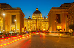 St. Peter`s cathedral in Rome, Italy. Road with car tile lights to St. Peter`s cathedral in Rome at night, Italy Royalty Free Stock Photography