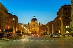 St. Peter's cathedral in Rome, Italy. Road to St. Peter's cathedral in Rome at night with lights, Italy Royalty Free Stock Images