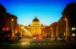 St. Peter`s cathedral in Rome, Italy. Road to St. Peter`s cathedral in Rome at night with lights, Italy, toned Stock Image