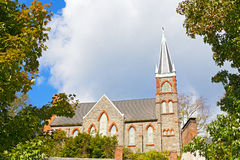 St. Peter`s Catholic Church in Harpers Ferry, West Virginia, USA. Beautiful church framed in autumn colors of deciduous trees Stock Images