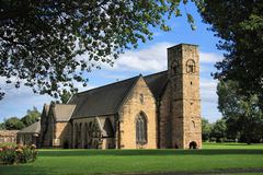 St Peter's Church & Roses. St Peter's Church at Monkwearmouth, Sunderland, Northeast England.  One half of the twin Anglo-Saxon monastery of Wearmouth-Jarrow ( Royalty Free Stock Images