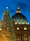 St. Peter's dome and Christmas tree. At night (Rome Royalty Free Stock Images
