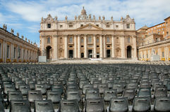 St Peter's Square and Basilica, Vatican City. St Peters Square , Vatican City-October 07,2008. In the foreground a St Peters Square and lots of empty chairs. The Royalty Free Stock Photography