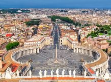 St. Peter`s square and Rome cityscape from top of St. Peter`s Cathedral, Vatican stock image