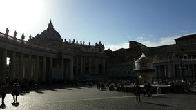 St. Peter`s Square. With tourists, fountains, obelisk and St. Peter´s Basilica in Vatican City in Rome Italy stock footage