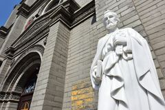 St. Peter`s statue in front of the church. The Catholic church built by a French Missionary since 1901 in Baoding City, Hebei Province, China Royalty Free Stock Photography