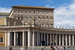 St. Peter square and pope's apartment. St. Peter square, and pope's apartment under blue sky Stock Photography