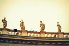 St. Peter square saints statues Vatican Stock Photos