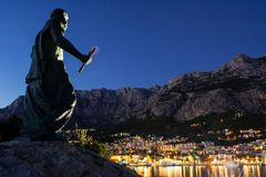 St Peter statue watching over the city of Makarska royalty free stock photo