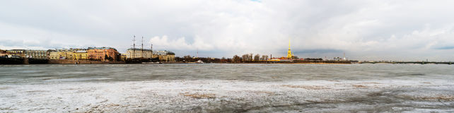 St Peterburg, Russia. Iced Neva river with Peter and Paul fortress. And Palace bridge in Saint Petersburg, Russia. Spring day with cloudy sky royalty free stock photography