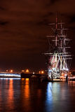 St.Peterburg. Russian ship. Russian ship in the night lights and bridge on background, St. Petersburg, Russia Royalty Free Stock Images