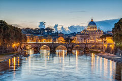 St. Peter's Basilica at dusk in Rome, Italy Stock Images