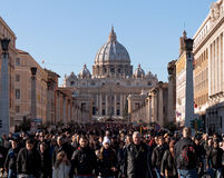 St. Peters Cathedral on christmas day. Crowd of people leaving St. Peters Cathedrals square on christmas day Royalty Free Stock Photo