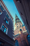 St Peters Church in old city Riga, Latvia. View from narrow street. Stock Image