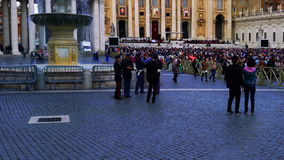 St. Peters Square on sunday. Saint Peter's Square, Vatican City - October 18, 2015 : People praying at Saint Peter's Square in Vatican City on sunday October 18 stock footage