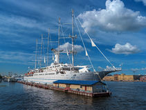 St. Petersbug, Russia - August 5, 2015: Cruise liner Wind Surf of Windstar Cruises Luxury Lines departs from the Neva river. Royalty Free Stock Image