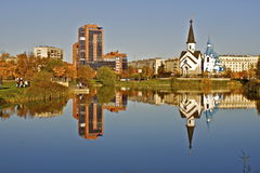 St. Petersburg. Reflection of a church and modern building in a lake in St. Petersburg Stock Photos