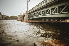 St. Petersburg, the bridge over the Neva river. The rain, cloudy typical Petersburg royalty free stock photo