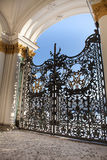 St. Petersburg, the central gate of the Hermitage, rich decor and golden monogram Royalty Free Stock Photo