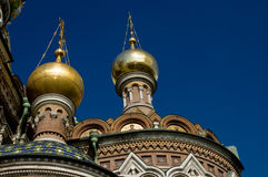 St Petersburg Church. Two gilded cupolas of the famous Church of the Saviour on the Spilled Blood in Saint Petersburg, Russia against a blue sky. The church is Royalty Free Stock Photos