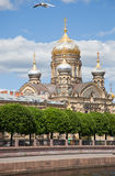 St. Petersburg. Church of the Dormition of the Theotokos. St. Petersburg. A view from Neva on church of the Dormition of the Theotokos and Lieutenant Schmidt stock photography