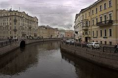 St. Petersburg The embankment facets the channel. Evening river bridges sidewalk architecture ancient balconies forging parapets stone blocks royalty free stock images