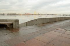 The granite embankment of the Neva. In St. Petersburg the embankment of the Neva river is lined with granite stone.This is a solid and durable material Stock Images