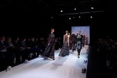 St. Petersburg Fashion Week Overview 2015. St. Petersburg, Russia - December 5, 2015: Collection of fashion holding Fabric Fancy at the fashion show during St Stock Images