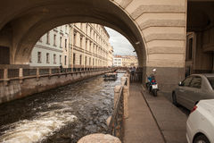 St. Petersburg, the geat arch over the canal near the Palace Embankment, pleasure boat Royalty Free Stock Photography