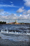 St. Petersburg - Between heaven and earth. Peter and Paul Cathedral and the Peter and Paul Fortress in a sunny weather Royalty Free Stock Image