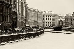 St. Petersburg Moika river embankment. Saint Petersburg, Russia: the Moika river embankment by a winter day covered by ice and snow with old architecture Royalty Free Stock Images