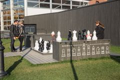 St.Petersburg, New Holland, outdoor chess. ST. PETERSBURG, RUSSIA - OCTOBER 16, 2018: New Holland, children play large outdoor chess stock photos