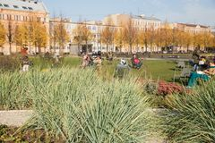 St.Petersburg, New Holland recreation area. ST. PETERSBURG, RUSSIA - OCTOBER 16, 2018: New Holland, recreation area in city center. Focus on flower bed, people stock photos