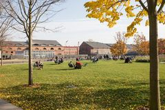 St.Petersburg. New Holland, recreation area. ST. PETERSBURG, RUSSIA - OCTOBER 16, 2018: New Holland, recreation area in city center. People rest on the lawn in royalty free stock image