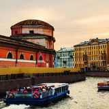 St Petersburg. Old residential buildings and touristic boats at Moyka river Royalty Free Stock Photos