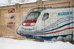 ST PETERSBURG ROSJA, LUTY, - 24: graffiti ROSJA, LUTY na ścianie o Fińskiej staci, - 24 2017 Obrazy Stock