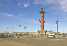 St. Petersburg Rostral column in sunny day. View of St. Petersburg Rostral columns in sunny day with wide street on the foreground Royalty Free Stock Photo