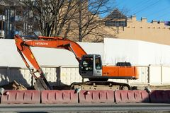Hitachi zaxis 330g crawler excavator for road works. St. Petersburg, Russia - April 06, 2019: hitachi zaxis 330g crawler excavator for road works in the city stock images
