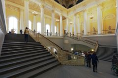 Main staircase of Russian Museum in St. Petersburg, Russia. St. Petersburg, Russia - April 24, 2017: People on the main staircase of the Russian Museum. It`s the Stock Photography