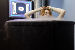 Woman takes cryotherapy treatment. St. Petersburg, Russia - April 13, 2017. Woman takes a cryotherapy treatment during he press tour to Krion enterprise. Founded Royalty Free Stock Photo
