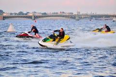 Athletes on a jet ski ride on the Neva river on the Troitsky bri Royalty Free Stock Image