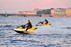 Athletes on a jet ski ride on the river Neva in the background o Stock Images