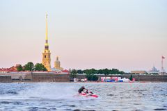The man on the jet ski quickly floats on the Neva river on the b Royalty Free Stock Images