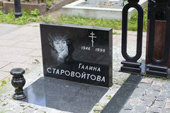 ST. PETERSBURG, RUSSIA -  AUGUST13, 2015: Photo of Monument Galina Starovoitova. Nikolskoye cemetery Stock Photos