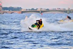 Sportsman jet ski rides on the Neva river on the Troitsky bridge Stock Image