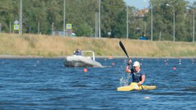 Young sportsman in a kayak in the summer Stock Photos