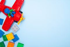 St.Petersburg, Russia- 06.03.19 - Baby kids toy frame. Top view conposition multicolor lego cubes bricks and plane on blue royalty free stock photography