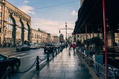 St. Petersburg, Russia - Circa June 2017: The historical center of St. Petersburg, Nevsky Prospekt, pavement, cafes, urban traffic. Ancient buildings stock image